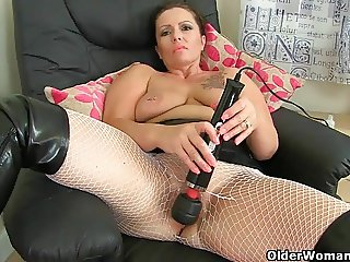 British milf Sam works her clit with a huge vibrator