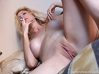 Sexy old spunker has a smoke & plays with her juicy pussy