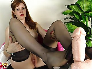Footjob By A Redhead In Stockings