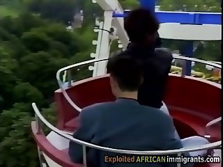 African babe gets pumped at ferris Wheel