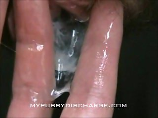 Horny milf playing with her cum on her lips