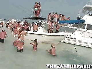 Group of babes dancing and flashing on some boats