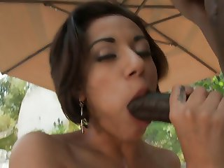 Cute faced Vanessa Leon gives head by the swiming pool and then sitting on a black cock