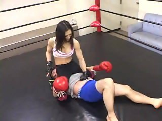 Sexy japanese fighter wrestler on the ring makes him suffer