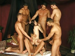 Horny hottie takes on a bunch of hard cock