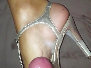 Cum on her sexy feet in heels