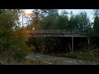 completely naked flashing traffic from a bridge