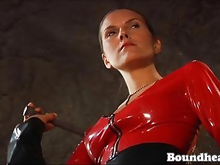 Two Ladies In Latex Whipping Tied Up Girl