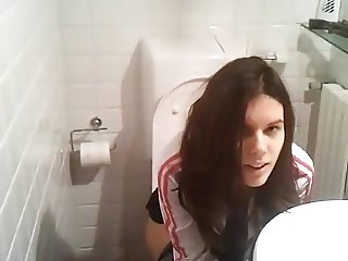 Cute amateur filmed peeing on toilet by friend