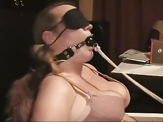 Blonde tied on a chair