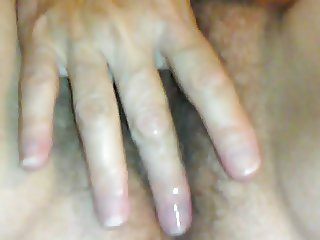 Wife playing with her hairy pussy