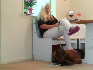 slave boy eating off the floor under his Goddess feet