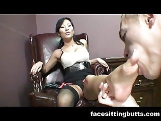Dirty Asian secretary has a foot fetish