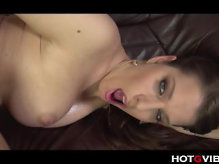 Brunette with big tits fingers her hole