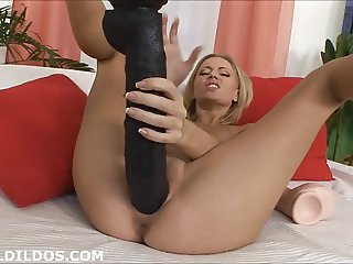 Hot blonde with two big dildos
