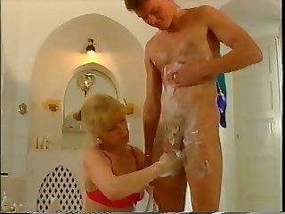 granny helping young guy to get clean in the shower TTT