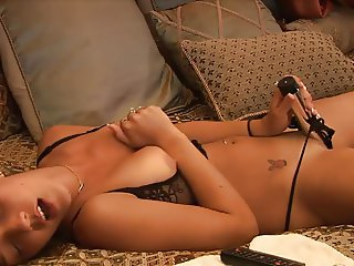 Christina in bed with vibrator