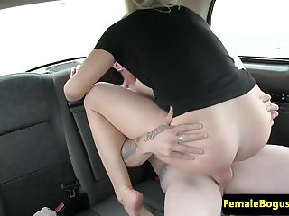 Female cabbie bangs customer in back of taxi