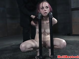 Restrained submissive tormented with toys