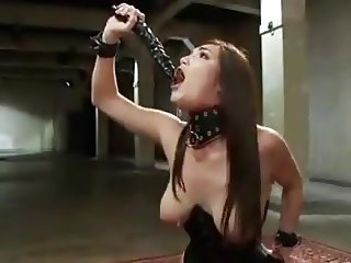 Slave gags training her throat with double dong