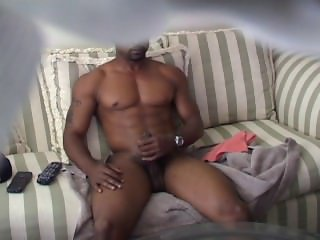 Ripped guy gets aroused by watching porn