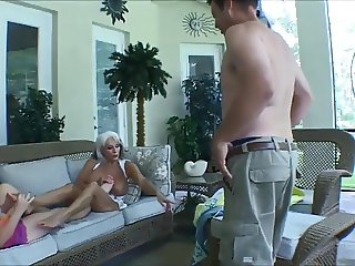 Two mature woman footjob on man