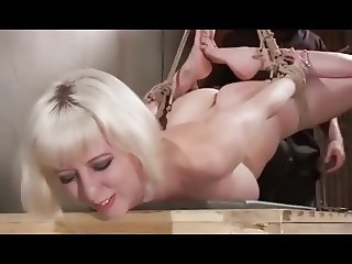 Painful pussy whipping for girl in Bondage