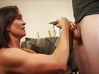Busty lady jerking off a dick