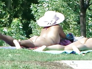 Oops short topless at the park