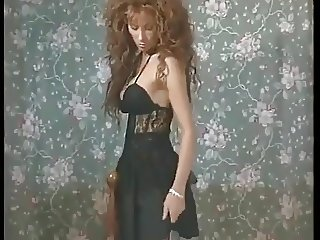 Older Vida Garman, sexy in black lingerie