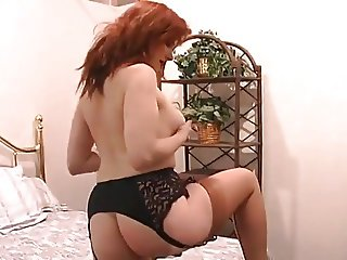 Busty Redhead In Retro Lingerie Using Toy