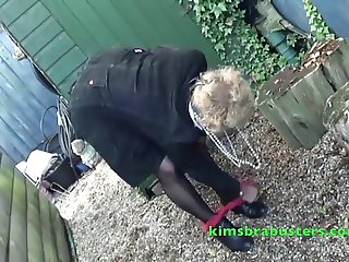 Hairy Granny behind the garden shed