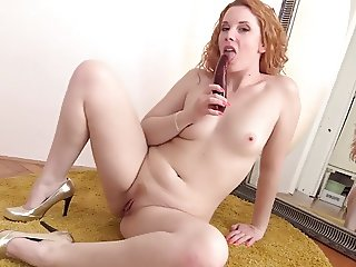 Toying pussy in front of a mirror