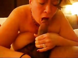 BBW with big boobs plays with black cock