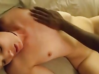 Brunette sucks a white cock and fucked by a black cock