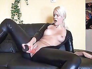 Hot german blonde in latex and boots fucks herself