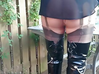 Thigh boots and layered in the garden