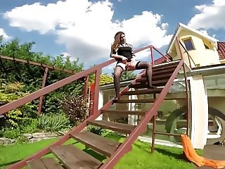 Kinky mommy piss on stairs and masturbates on backyard