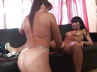 Old slut and gorgeous brunette have dildo fuck on the couch