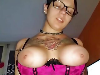 Busty tattooed hottie rides a swallows a load
