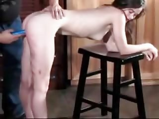 Petite woman caned and dildoed