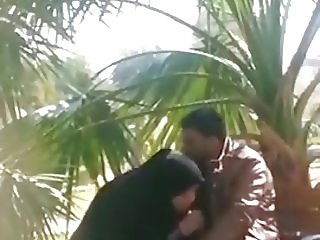 An Iraqi girl sucks her lover 's penis in a public place