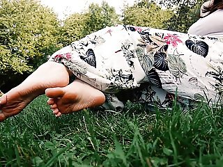 Sandals and barefoot in the grass