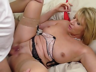 Two mature moms suck and fuck lucky sons