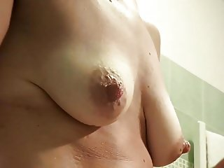 Spycam - nude in bathroom - most focus on boobs
