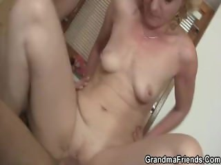 Mature slut takes two cocks