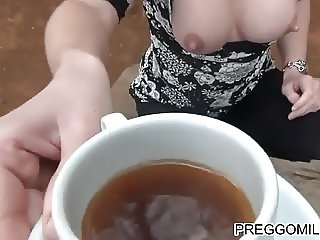 a cup of lactation tea in the woods