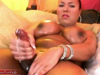 Black doll with balls in leopard boots squirts lots of cum