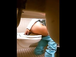 Hiddencam girl put big butt plug in in public toilet