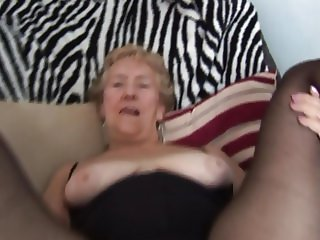 Granny in crotchless pantyhose showing off her hairy pussy